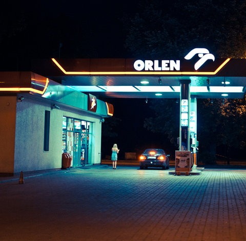 blue neon petrol station garage photograph